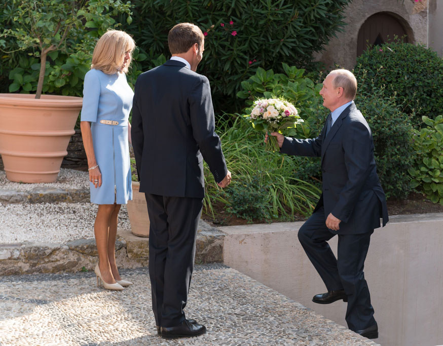Macron and Brigitte Macron, flowers, celebrity style, Louis Vuitton eyeliner pump, France First Lady