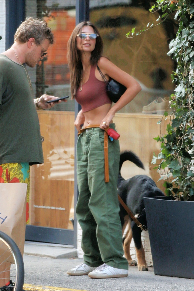 Emily Ratajkowski, abs, crop top, street style, celebrity style, Adidas samba sneakers, Model Emily Ratajkowski, wearing green khakis and crop top, walks home from lunch with her husband Sebastian Bear-McClard and their dog Colombo in Soho in New York CityPictured: Emily RatajkowskiRef: SPL5109764 170819 NON-EXCLUSIVEPicture by: Christopher Peterson / SplashNews.comSplash News and PicturesLos Angeles: 310-821-2666New York: 212-619-2666London: 0207 644 7656Milan: +39 02 56567623photodesk@splashnews.comWorld Rights