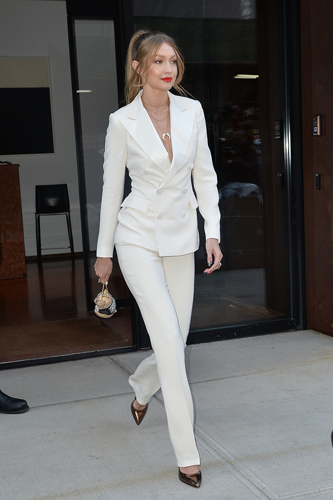 Gigi Hadid wearing an all-white pantsuit in October 2018.