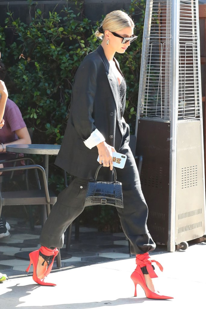 Hailey baldwin, business suit, balenciaga handbag, balenciaga fall 2019 red pumps, stilettos, Los Angeles, august 2019, Celine sunglasses