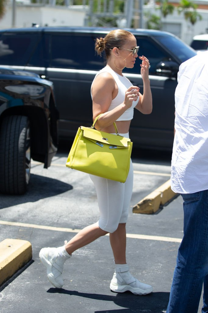 Jennifer Lopez, celebrity style, gym, Miami, sneakers, bike shorts, legs, abs, sports bra, toned arms, sunglasses, Hermes, birkin bag,