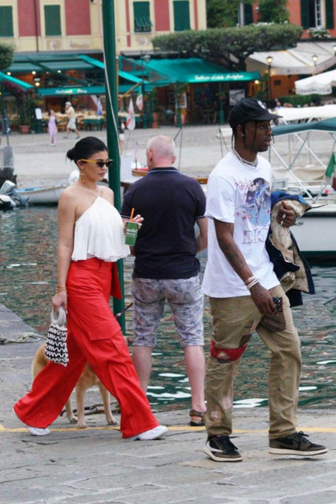travis Scott, Kylie jenner, vacation, italy, portofino, celebrity shoe style, travis Scott x air Jordan 1 low sneaker, vetements x reebok spike 200 runner,
