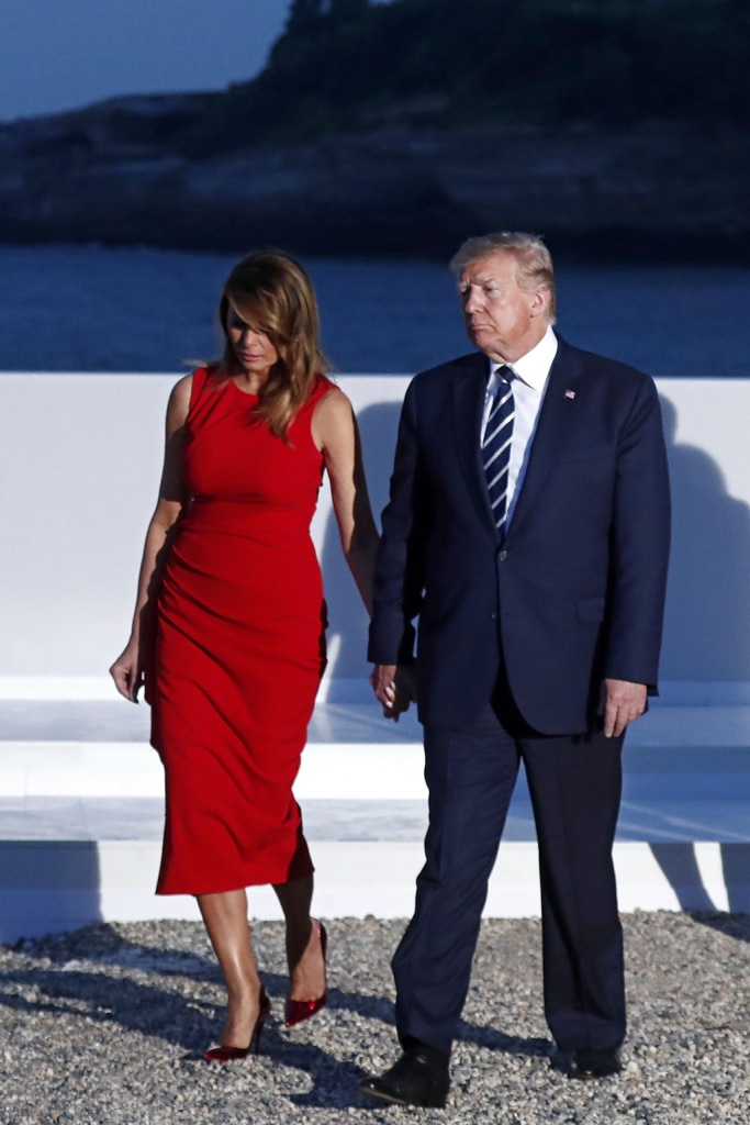 melania trump, Alexander McQueen dress, christian Louboutin so Kate pumps, celebrity shoe style, US President Donald J. Trump (R) and hsi wife Melania Trump (L) walk after posing for the family photo during the G7 summit at Casino in Biarritz, France, 25 August 2019. The G7 Summit runs from 24 to 26 August in Biarritz.G7 Summit Biarritz in France, Bayonne - 25 Aug 2019