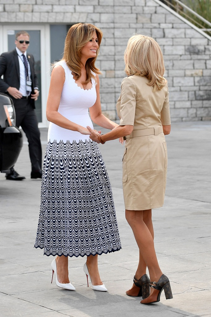 melania trump, alaia dress, christian Louboutin so Kate pumps, Brigitte macron, Louis Vuitton matchmaker pumps, celebrity shoe style, French first lady Brigitte Macron (R) greets US First Lady Melania Trump (L)upon her arrival by the Cote des Basques beach as part of the G7 summit, in Biarritz, France, 26 August 2019. The G7 Summit runs from 24 to 26 August in Biarritz.G7 Summit Biarritz in France - 26 Aug 2019