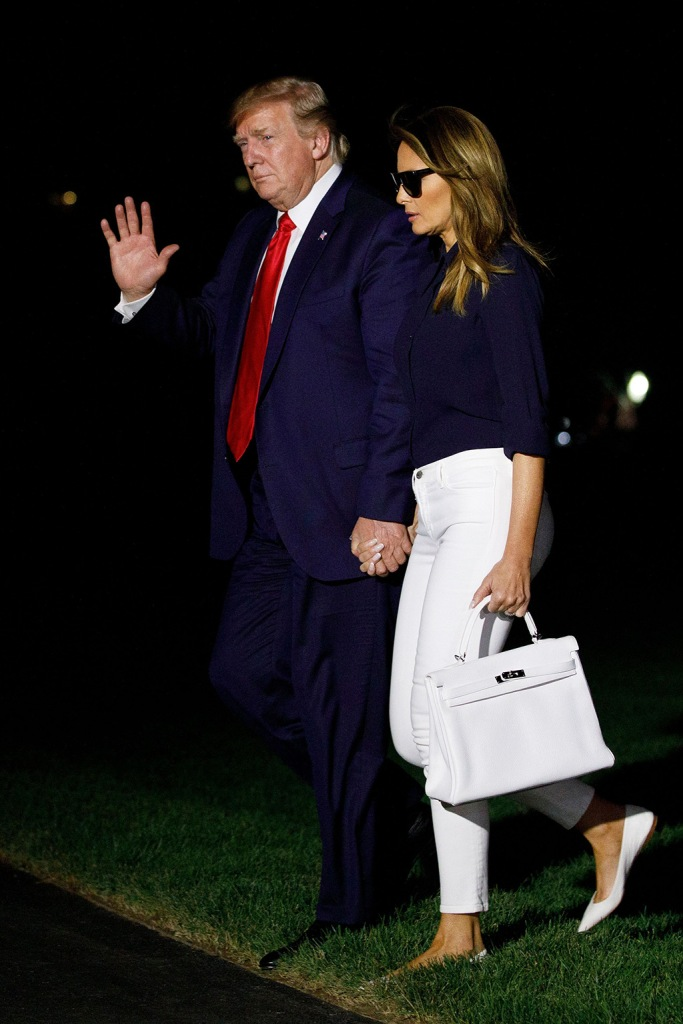 Donald Trump, Melania Trump, Hermes handbag, white flats, louboutin shoes, ballet flats, celebrity style, white jeans, first lady, President Donald Trump and first lady Melania Trump walk from Marine One to the White House, as they return from attending the G-7 summit in Biarritz, FranceTrump, Washington, USA - 26 Aug 2019