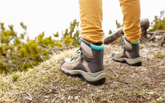 Back view close up of woman wearing yellow pants and hiking boots outdoors - adventure concept; Shutterstock ID 318496403; Usage (Print, Web, Both): Web; Issue Date: 8/20, Best mountaineering boots, best mountaineering boots amazon