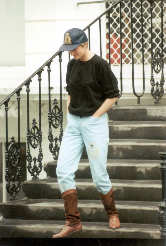 Princess DianaA Smiling Diana Princess Of Wales Pictured After Dropping Prince Harry Off At School She Is Wearing Cowboy Boots And A Baseball Cap.