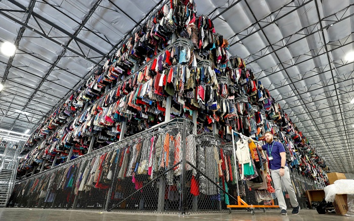 "Thousands of garments are stored on a three-tiered conveyor system at the ThredUp sorting facility in Phoenix. Charitable organizations like Goodwill have cited how Marie Kondo's popular Netflix series, ""Tidying up with Marie Kondo"" has led to a surge of donations. And sites like OfferUp and thredUP also note an uptick in the number of items being sent to them for saleOn The Money Decluttering Tips, Phoenix, USA - 10 Mar 2019"