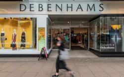 Consumers pass by Debenhams on Oxford