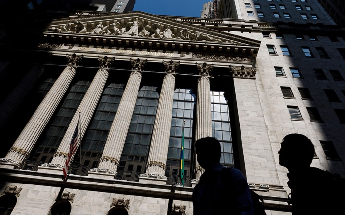 People walk past the New York Stock Exchange as investors reacted to news that President Trump was considering a new five percent tariff on all goods from Mexico in New York, New York, USA, 31 May 2019. Trump's announcement of the tariffs, which would begin on 10 June 2019, were an effort to pressure Mexico to do more to stop the flow of undocumented immigrants to the United States border.New York Stock Exchange Reacts to Proposed Mexico Tariffs, USA - 31 May 2019