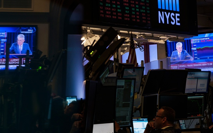 Traders work near television screens showing a news conference with United States Federal Reserve chairman Jerome Powell where he was discussed the Fed's decision to lower interest rates by a 1/4 point on the floor of the New York Stock Exchange in New York, New York, USA, 31 July 2019. The United States Federal Reserve lowered the key interest rate quarter a point for the first time since the 2008 financial crisis.New York Stock Exchange Fed Cuts Interest Rate, USA - 31 Jul 2019