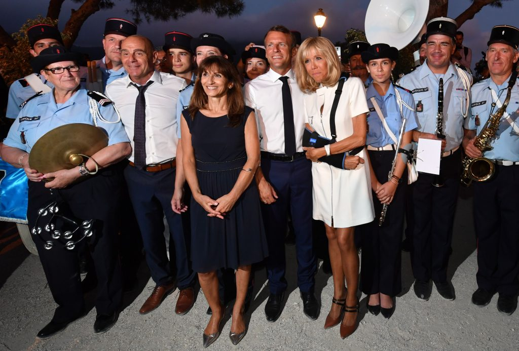 MAXPPP OUTMandatory Credit: Photo by YANN COATSALIOU/POOL/EPA-EFE/Shutterstock (10364062ao)French President Emmanuel Macron (C) his wife Brigitte Macron (C-R) and Mayor of Bormes-les-Mimosas Francois Arizzi (2-L) pose with gendarmes, at the end of a ceremony marking the 75th anniversary of the Allied landings in Provence in World War II which helped liberate southern France, in Bormes-les-Mimosas, France, 17 August 2019.75th anniversary of the Allied landings in Provence, Bormes-Les-Mimosas, France - 17 Aug 2019