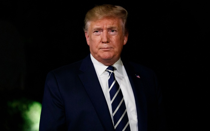 President Donald Trump listens to a reporter's question as he walks to Marine One on the South Lawn of the White House, in Washington. Trump is en route to the G-7 summit in FranceTrump, Washington, USA - 23 Aug 2019