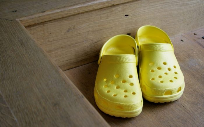 Crocs on wooden floorVARIOUS