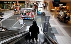 A shopper rides an escalator at