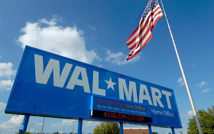 A sign stands in front of the Wal-Mart Stores Inc. headquarters in Bentonville, Ark., in this photo. Wal-Mart founder Sam Walton purchased his first aluminum airplane in 1954. Eventually, his company grew into one of retail's largest corporate jet fleets in part because of Walton's passion for flightWalmart Flights, Bentonville, USA