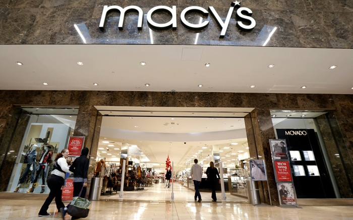 People walk into an entrance to Macy's department store at Garden State Plaza, in Paramus, N.JNew Jersey Retailer Stores, Paramus, USA - 25 Oct 2017
