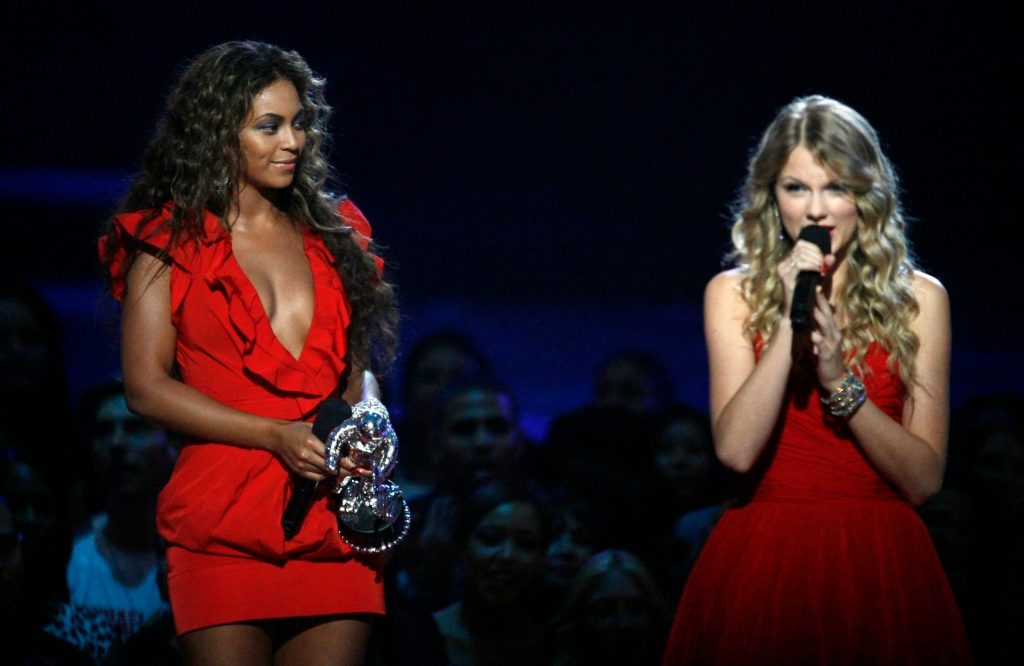 Beyonce, Taylor Swift, red dress, Beyonce, left, holds her Video of the Year award while Taylor Swift addresses the crowd at the MTV Music Video Awards, in New YorkMTV Video Music Awards Show, New York, USA - 13 Sep 2009