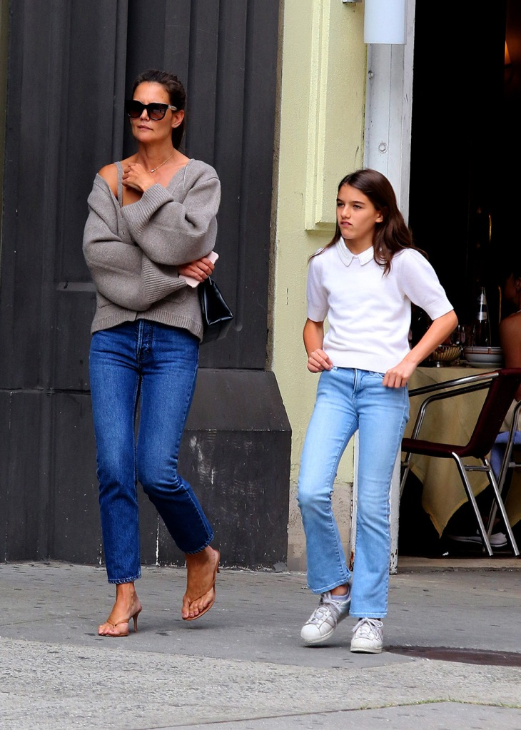 Katie Holmes, mom jeans, sweater, celebrity style, high heeled flip-flops, thong, sandals, kitten heels, gianvito rossi shoes, suri cruise, Adidas superstar sneakers, white sneakers, shows some major cleavage while hailing a cab with her daughter Suri Cruise in Downtown Manhattan. The mother and daughter duo had lunch together at a Downtown Soho restaurant and they later walked and spent more than 2 hours shopping and browsing the local shops in the Soho neighborhood. At one point Suri is seen sharing her drink with her mother and finally ended their outing by hailing a Taxi together. 27 Aug 2019 Pictured: Katie Holmes and Suri Cruise. Photo credit: LRNYC / MEGA TheMegaAgency.com +1 888 505 6342 (Mega Agency TagID: MEGA489849_023.jpg) [Photo via Mega Agency]