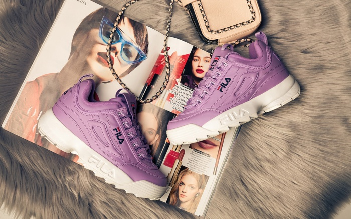 New beautiful colorful and nice Fila Disruptor running shoes, sneakers, trainers shows logo with a brand box on abstract background. Sport and casual footwear concept. Kyiv, Ukraine-September 16, 2018; Shutterstock ID 1247522314; Usage (Print, Web, Both): Web; Issue Date: 8-22-19; Comments: For web story, best trendy sneakers women