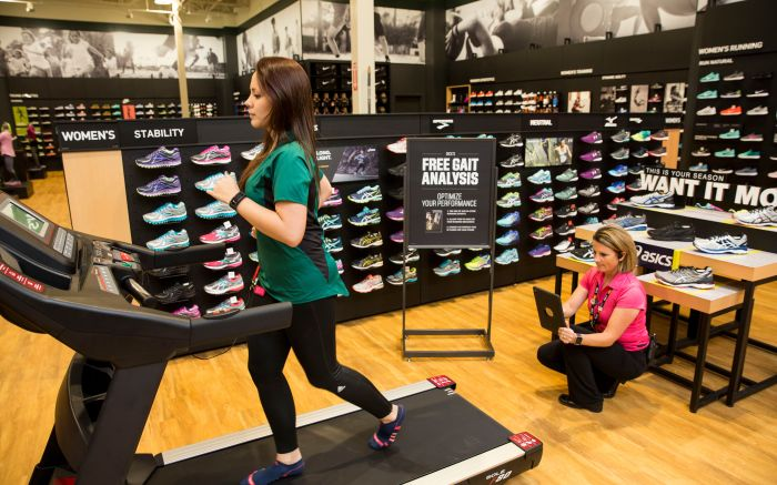A sales associate demonstrates a custom shoe fitting at the new DICK'S Sporting Goods store at Baybrook Mall in Friendswood, Texas on . The new store is one of six new locations now open for business in the Houston areaDICK'S Sporting Goods Grand Opening Celebration, Houston, USA