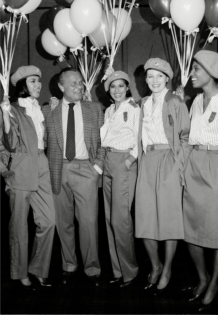Blass Fashion designer Bill Blass poses with models wearing his new look for adult Girl Scouts at New York's Fourt Seasons restaurant, . The new design is presented in a dracon polyester dress as well as the pant and jacket uniformsFASHION BLASS GIRL SCOUT LOOK, NEW YORK, USA