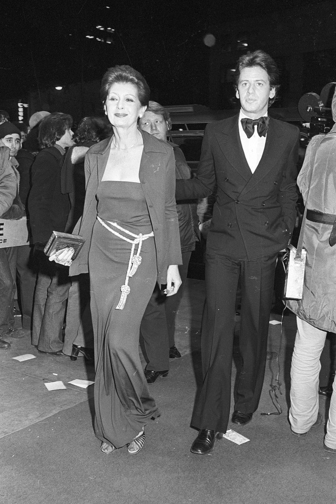Roy Halston and friend attend the movie premiere party for 'The Towering Inferno' thrown by 20th Century Fox's Dennis and Terry Stanfill at the Four Seasons on December 18, 1974 in New York...Article title: 'Eye View: The Firemen's BallThe Towering Inferno' Premiere, New York