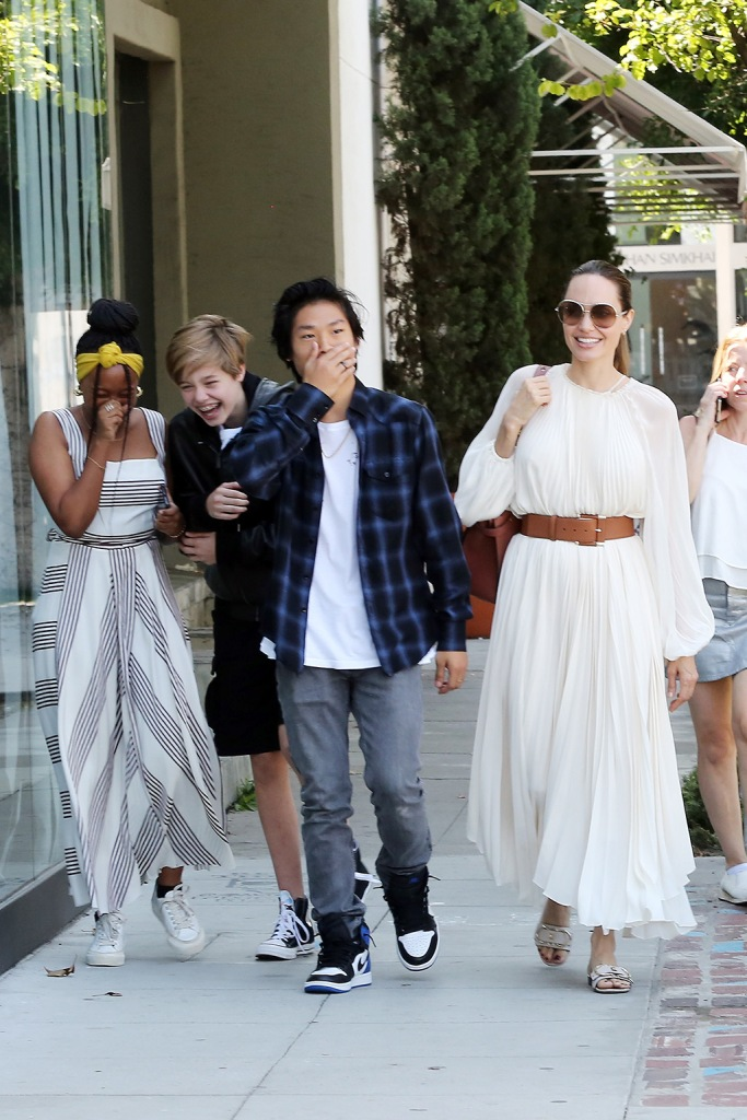 Angelina Jolie, Sahara, pax, shiloh, the row dress, Ferragamo sandals, and her children enjoy lunch at Fig and Olive in West Hollywood on Labor Day Monday. 02 Sep 2019 Pictured: Angelina Jolie, Pax, Zahara. Photo credit: Rachpoot/MEGA TheMegaAgency.com +1 888 505 6342 (Mega Agency TagID: MEGA493932_016.jpg) [Photo via Mega Agency]