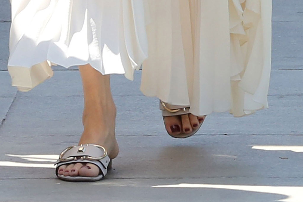 Angelina Jolie, white sandals, Ferragamo shoes, pedicure, red nail polish, toes, feet, Los Angeles, Labor Day 2019