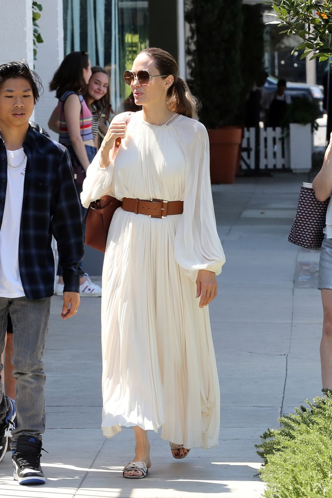 Angelina Jolie, the row dress, white dress, Ferragamo sandals, white sandals, celebrity style, sunglasses, fendi purse, and her children enjoy lunch at Fig and Olive in West Hollywood on Labor Day Monday. 02 Sep 2019 Pictured: Angelina Jolie, Pax, Zahara. Photo credit: Rachpoot/MEGA TheMegaAgency.com +1 888 505 6342 (Mega Agency TagID: MEGA493932_005.jpg) [Photo via Mega Agency]