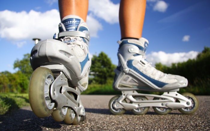 Rollerblades / inline skates closeup in action outdoors on sunny day.; Shutterstock ID 34622002; Usage (Print, Web, Both): Web; Issue Date: 9/4