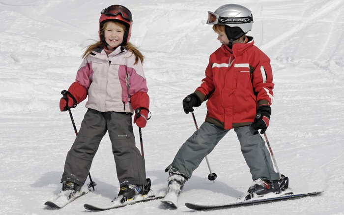 MODEL RELEASED Two children skiing in the mountainsVARIOUS