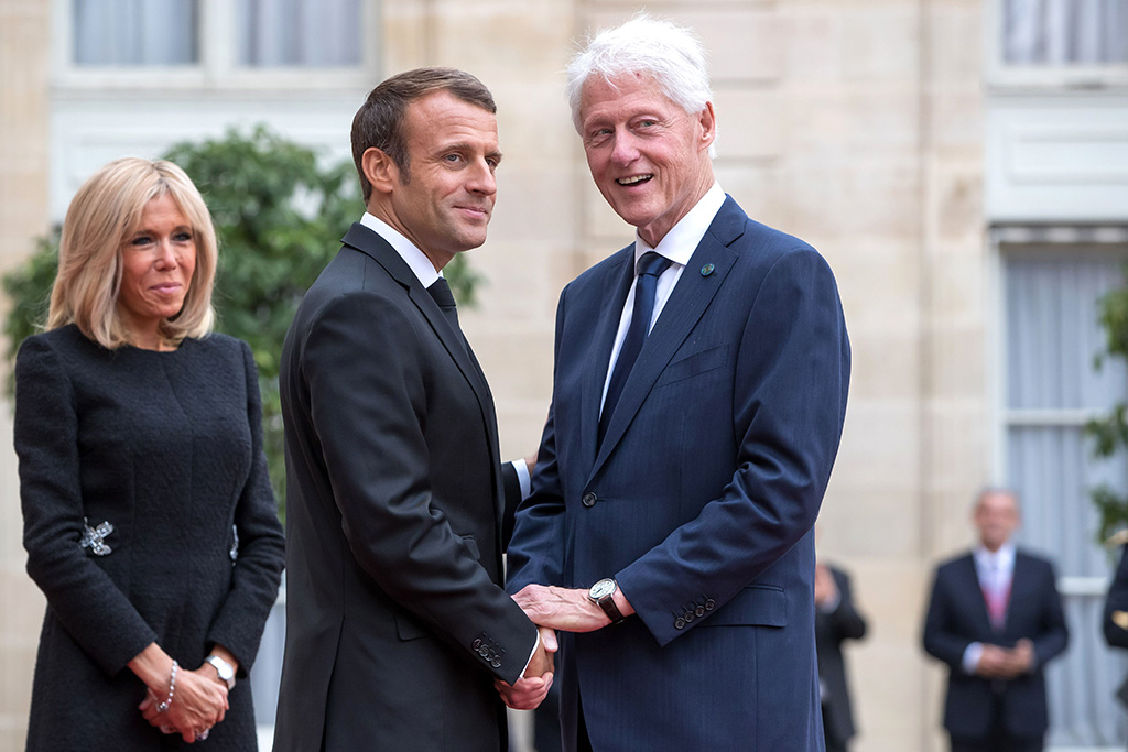 French President Emmanuel Macron (C) and his wife Brigitte Macron (L) welcome US former President Bill Clinton (R), ahead of a lunch for the visiting leaders and heads of state, following a memorial for French former President Jacques Chirac, at the Elysee Palace in Paris, France, 30 September 2019. Jacques Chirac died on 26 September in Paris, aged 86. The 30th September 2019 has been declared a day of national mourning in France.Funeral for former French president Jacques Chirac, Paris, France - 30 Sep 2019
