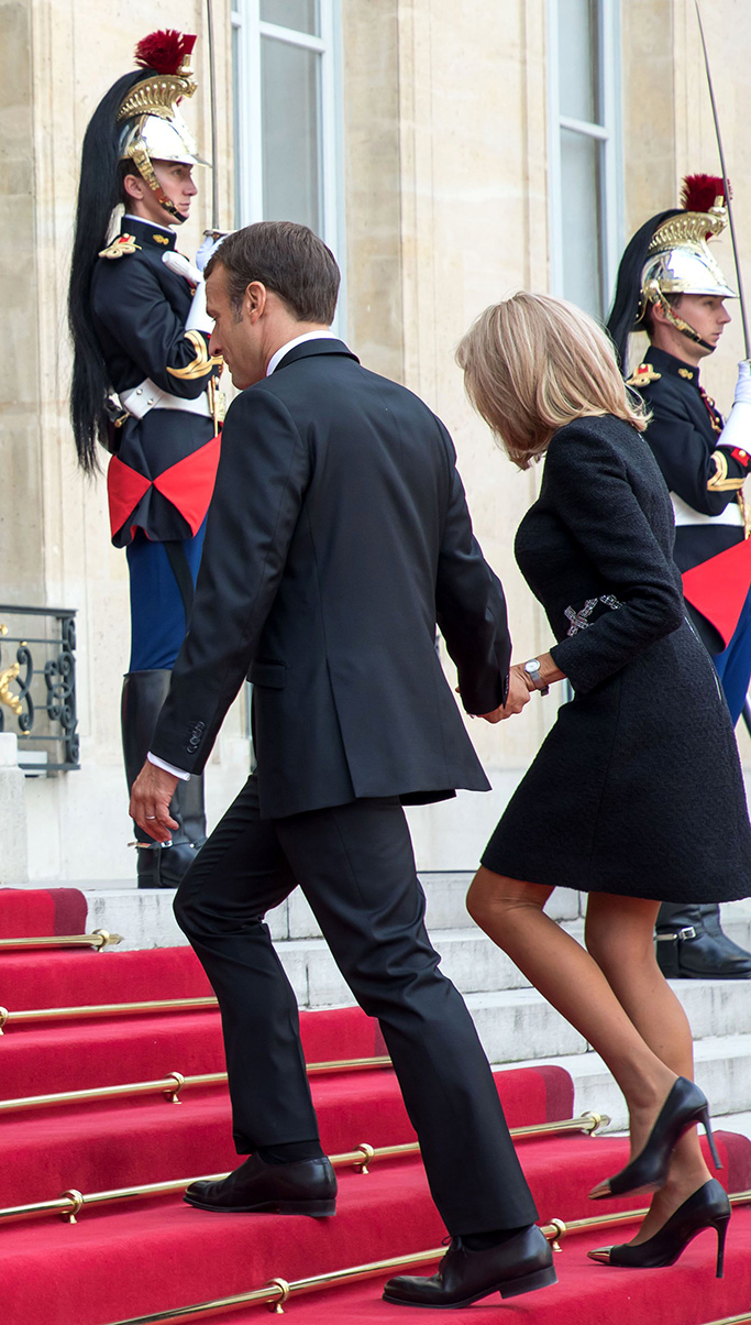 French President Emmanuel Macron (C) and his wife Brigitte Macron (R) welcome French former President Francois Hollande (L), ahead of a lunch for the visiting leaders and heads of state, following a memorial for French former President Jacques Chirac, at the Elysee Palace in Paris, France, 30 September 2019. Jacques Chirac died on 26 September in Paris, aged 86. The 30th September 2019 has been declared a day of national mourning in France.Funeral for former French president Jacques Chirac, Paris, France - 30 Sep 2019