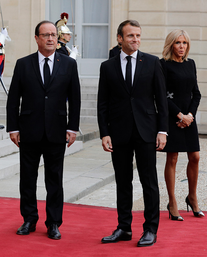 Former French President Francois Hollande, left, current French President Emmanuel Macron and his wife Brigitte Macron pose at the Elysee Palace after a service at Saint Sulpice church for late French President Jacques Chirac, in Paris. Former French President Jacques Chirac was given full military honors on Monday as past and current world leaders gathered in Paris to attend his final serviceChirac, Paris, France - 30 Sep 2019
