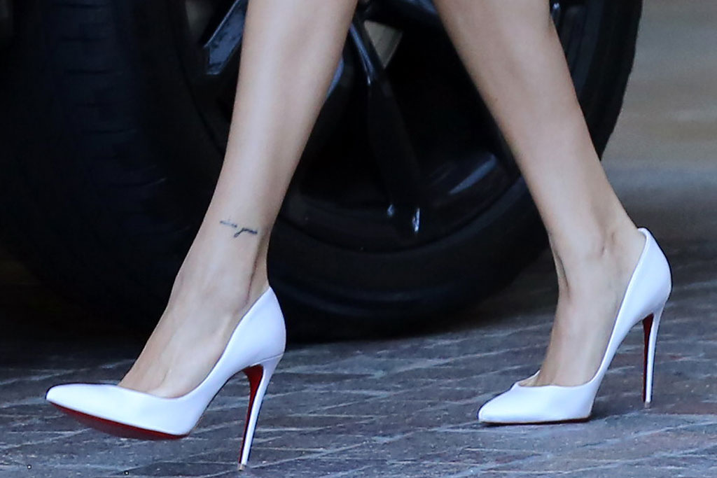 Hailey Baldwin, Bieber, legs, ankle tattoo, Christian louboutin, stilettos,, celebrity style, maison marginal, skirt, shirt, legs, celebrity style, la, gold earrings, Jennifer fisher