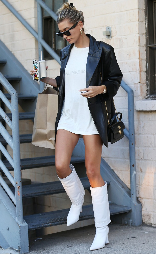 Hailey Baldwin, Jacquemus boots, celebrity style, legs, pantless, j brand x Elsa hosk jacket, leather blazer, Maison margiela t-shirt, Celine sunglasses, blond hair, bun, Socialite and model Hailey Rhode Bieber in white boots and jacket strolling in Beverly Hills, CA, USA.Pictured: Hailey Bieber,Hailey Rhode BieberRef: SPL5116455 170919 NON-EXCLUSIVEPicture by: ENT / SplashNews.comSplash News and PicturesLos Angeles: 310-821-2666New York: 212-619-2666London: +44 (0)20 7644 7656Berlin: +49 175 3764 166photodesk@splashnews.comWorld Rights, No France Rights, No Italy Rights, No Japan Rights
