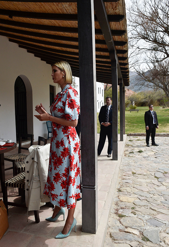 Ivanka Trump, Proenza Schouler dress, blue heels, President Donald Trump's daughter and White House adviser, holds a pastry as bakery owner Cristina Alcoser fills it with caramel as Ivanka Trump visits the bakery in Jujuy, Argentina, . Ivanka Trump is on the second stop of her South America trip aimed at promoting women's empowermentIvanka Trump, Jujuy, Argentina - 05 Sep 2019