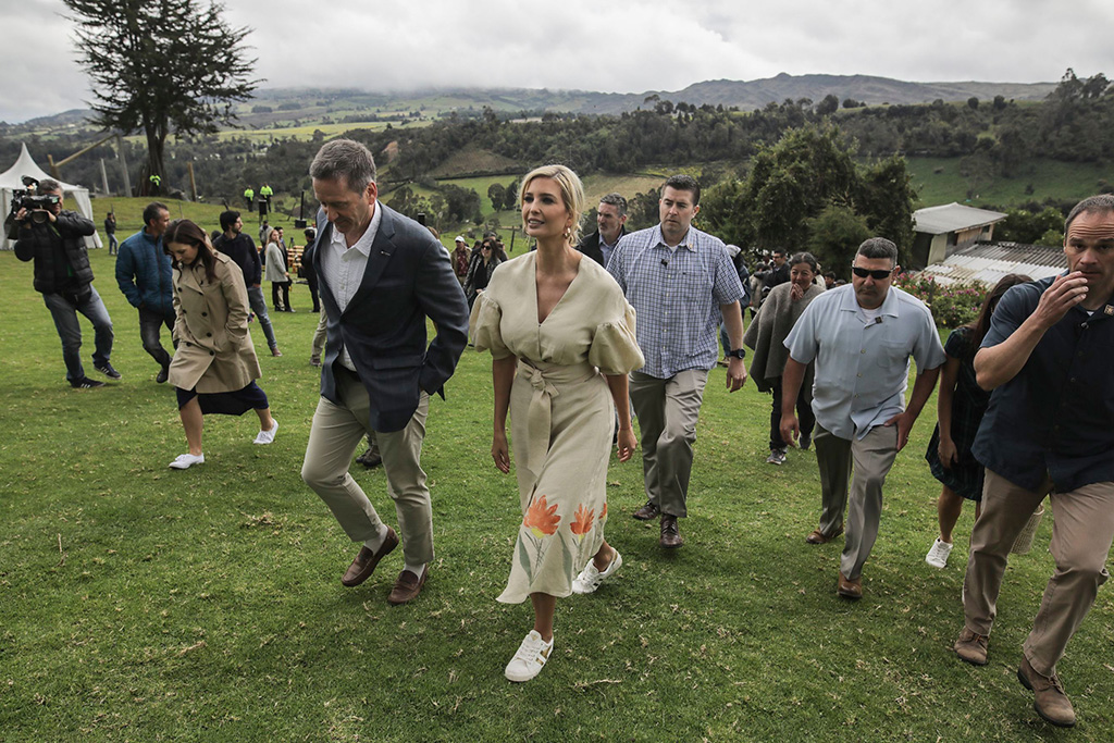 Ivanka Trump, President Donald Trump's daughter and White House adviser, tours a women-run strawberry farm in Usme, Colombia, . Ivanka Trump is kicking off her trip to South America by promoting women's empowermentIvanka Trump, Usme, Colombia - 04 Sep 2019. Ivanka Trump, celebrity style, gold sneakers, gola, j crew, SILVIA TCHERASSI dress, floral dress, White House advisor, v-neck dress, hoop earrings, strawberry field, Colombia