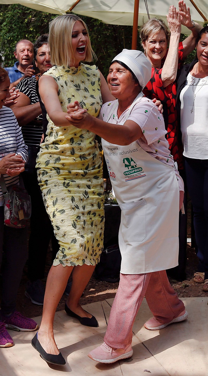 rothys flats, black with blue heel tab, purple heel tab lining, Ivanka Trump, center left, President Donald Trump's daughter and White Houses advisor, dances with a farmer during a roundtable at El Granel coffee shop in Asuncion, Paraguay, . Ivanka Trump is on her third stop of a South American trip to promote women's empowermentIvanka Trump, Asuncion, Paraguay - 06 Sep 2019