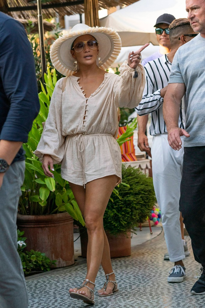 Jennifer Lopez, gladiator sandals, sabo playsuit, legs, celebrity style, vacation, saint tropez, floppy hat, aviator sunglasses, hoop earrings, and Alex Rodriguez and friends strolling on the port during holiday in St Tropez. 04 Sep 2019 Pictured: Jennifer Lopez and Alex Rodriguez and friends strolling on the port during holiday in St Tropez Set ID: 602538. Photo credit: Eliot Press / ELIOTPRESS / MEGA TheMegaAgency.com +1 888 505 6342 (Mega Agency TagID: MEGA495370_010.jpg) [Photo via Mega Agency]