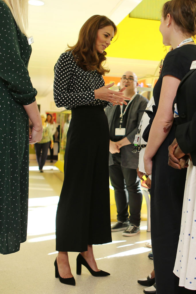 Kate middleton, black trousers, polka dot top, equipment shirt, black pumps, pointy toe heels, Catherine Duchess of Cambridge visits Sunshine House Children and Young People's Health and Development Centre, Peckham, London, UK - 19 Sep 2019
