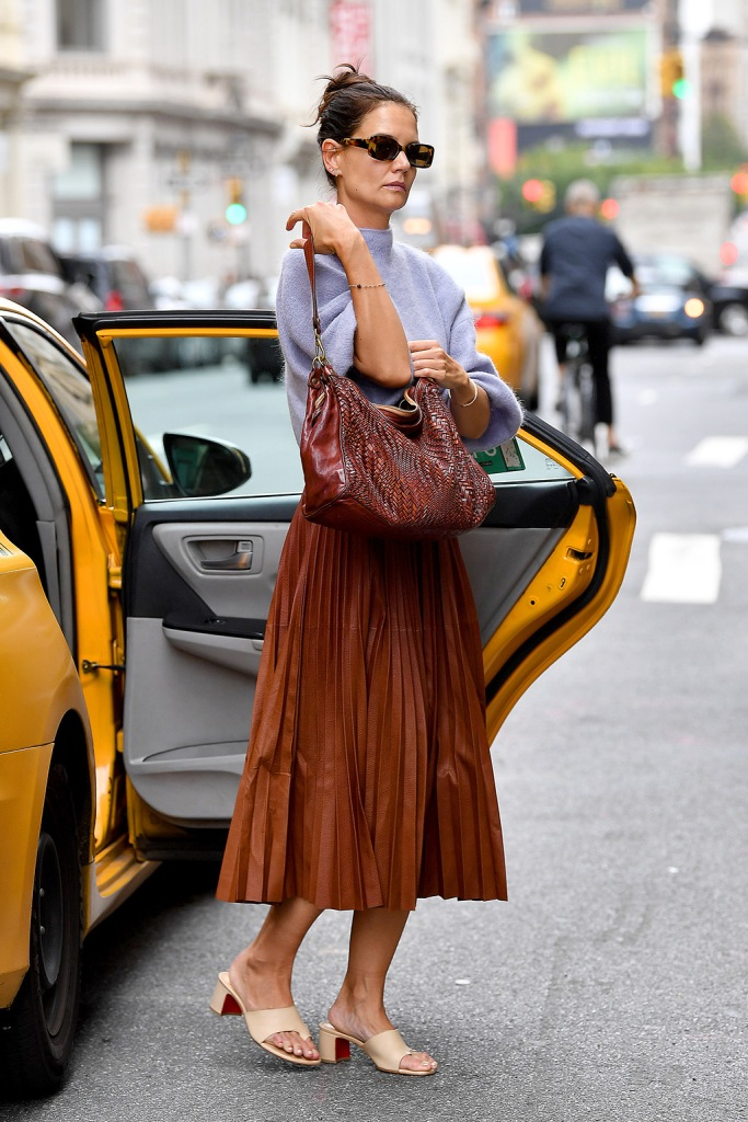 Katie Holmes, christian louboutin mules, big-toe-sandals, celebrity style, midi skirt, sweater, handbag, grabs a cab in New York CityPictured: Katie HolmesRef: SPL5115746 140919 NON-EXCLUSIVEPicture by: Robert O'Neil / SplashNews.comSplash News and PicturesLos Angeles: 310-821-2666New York: 212-619-2666London: +44 (0)20 7644 7656Berlin: +49 175 3764 166photodesk@splashnews.comWorld Rights