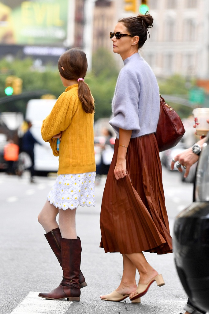 Katie Holmes, suri cruise, daisy skirt, yellow sweater, brown boots, celebrity style, mother, daughter, Katie holmes, midi skirt, big-toe sandals, and daughter Suri wear their sweaters in New York CityPictured: Katie Holmes,Suri CruiseRef: SPL5115747 140919 NON-EXCLUSIVEPicture by: Robert O'Neil / SplashNews.comSplash News and PicturesLos Angeles: 310-821-2666New York: 212-619-2666London: +44 (0)20 7644 7656Berlin: +49 175 3764 166photodesk@splashnews.comWorld Rights