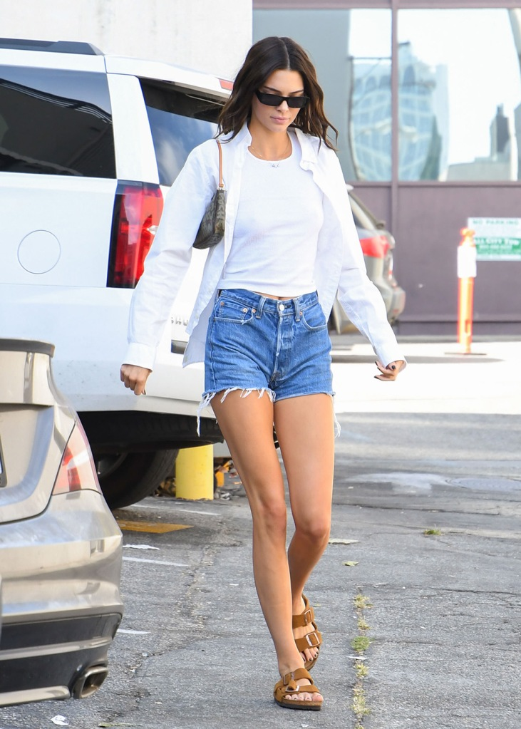 Kendall Jenner, denim shorts, daisy dukes, legs, white button-down, birkenstock sandals, shoe style, street style, is seen in Los Angeles, California.Pictured: Kendall JennerRef: SPL5118340 250919 NON-EXCLUSIVEPicture by: Bauer-Griffin / SplashNews.comSplash News and PicturesLos Angeles: 310-821-2666New York: 212-619-2666London: +44 (0)20 7644 7656Berlin: +49 175 3764 166photodesk@splashnews.comWorld Rights