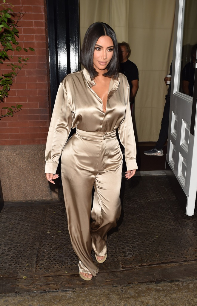 kim kardashian, silk set, sandals, yeezy, thongs, heeled flip-flops, Reality TV Star Kim Kardashian is seen leaving the Mercer hotel to go to early morning TV in New York City, NY, USA.Pictured: Kim KardashianRef: SPL5114610 100919 NON-EXCLUSIVEPicture by: New Media Images / SplashNews.comSplash News and PicturesLos Angeles: 310-821-2666New York: 212-619-2666London: +44 (0)20 7644 7656Berlin: +49 175 3764 166photodesk@splashnews.comWorld Rights