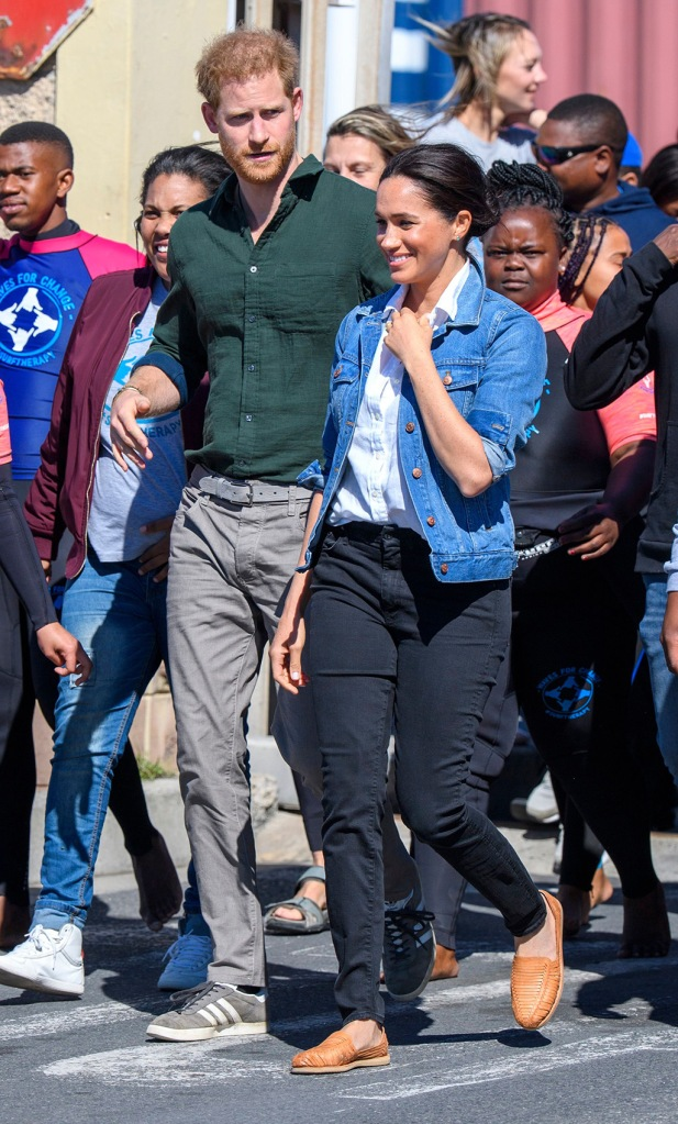 meghan markle, jean jacket, huaraches, brother vellies shoe, celebrity style, madewell jacket, purse, Prince Harry and Meghan Duchess of Sussex at Monwabisi Beach in Cape Town, South AfricaPrince Harry and Meghan Duchess of Sussex visit to Africa - 24 Sep 2019