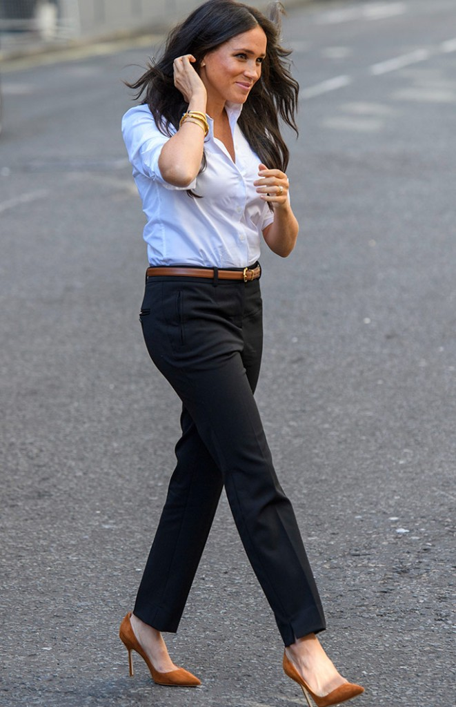 Meghan Markle launches her Smart Works charity capsule wearing a white shirt by Misha Nonoo and black pants by Jigsaw from the range that she helped to design.