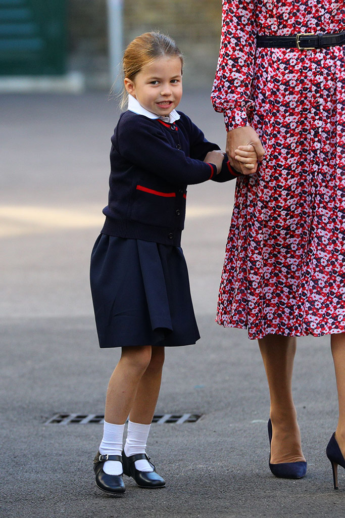 Princess Charlotte holds mother, Kate Middleton's hand on her first day at school.