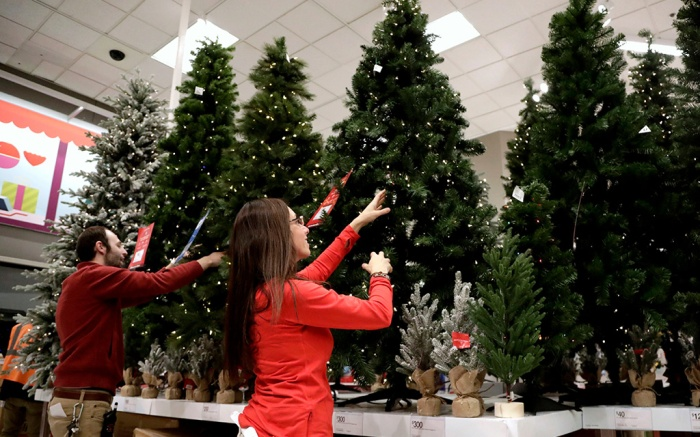 Employees work on the presentation of Christmas trees at a Target store in Bridgewater, N.J. On Wednesday, Dec 5, the Institute for Supply Management, a trade group of purchasing managers, issues its index of non-manufacturing activity for NovemberService Sector, Bridgewater, USA - 15 Nov 2018